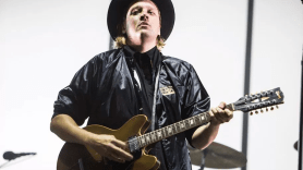 Arcade Fire's Win Butler, photo by Philip Cosores