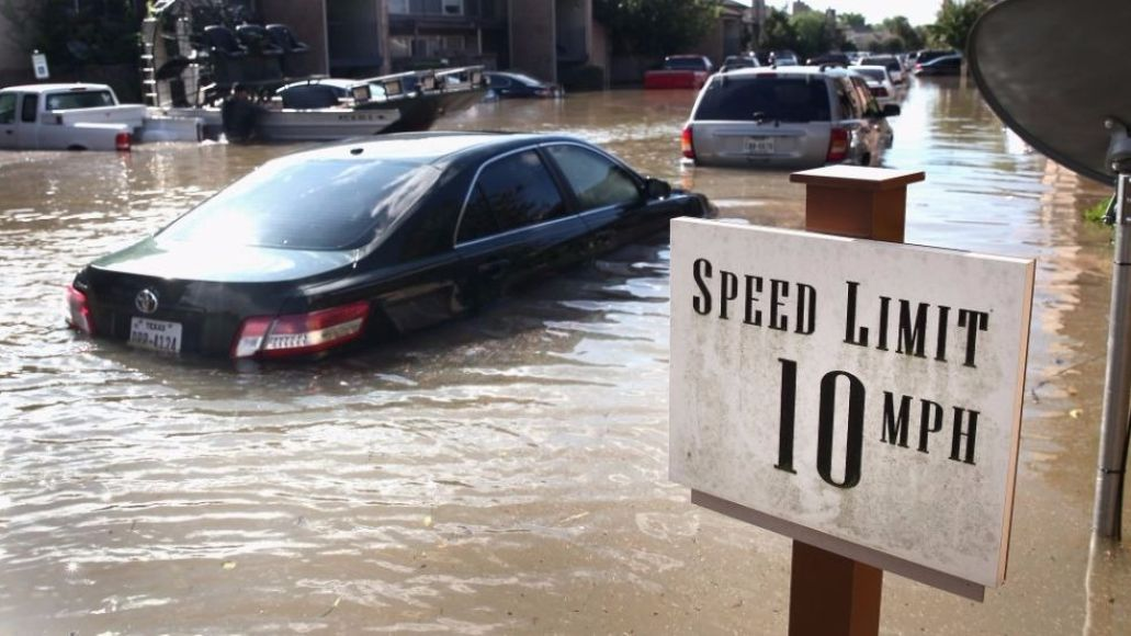 Flood flooded road cars speed limit sign