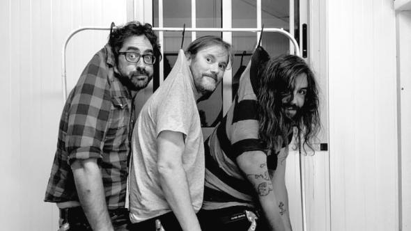 Beak> Jamie Orchard Lisle black and white hanging by shirt clothes hanger rack