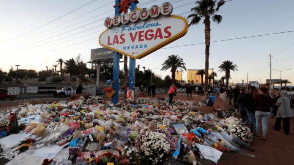 Las Vegas Shooting Route 91 Harvest Festival Investigation closed sign flowers