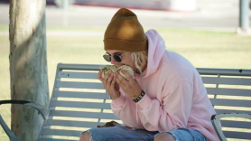 Justin Bieber eating a burrito