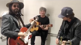 Mike Campbell, Eddie Vedder, and Liam Finn jam out in the bathroom