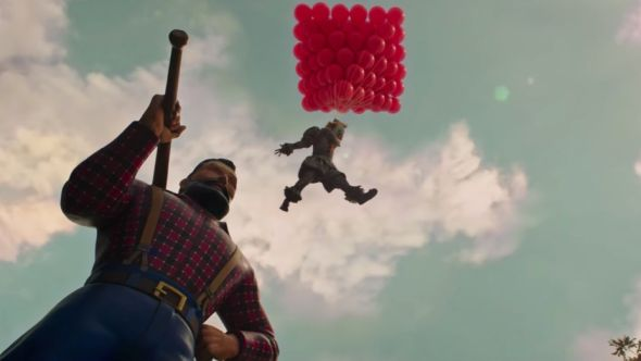 Pennywise holding balloons in It: Chapter Two