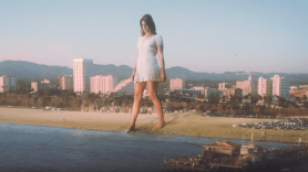 Lana Del Rey doin' time music video attack of the 50 foot tall woman