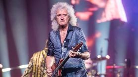 Brian May of Queen tears butt muscles