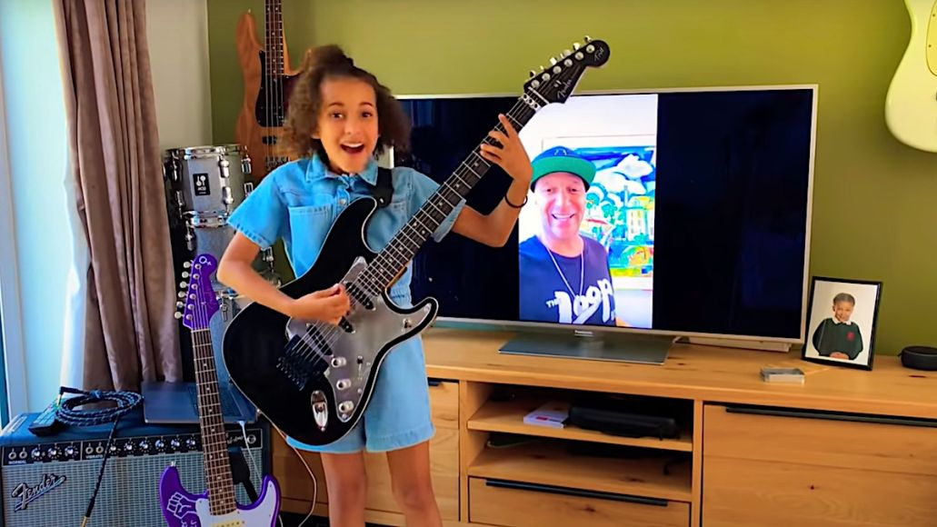 Tom Morello gifts guitar to young girl