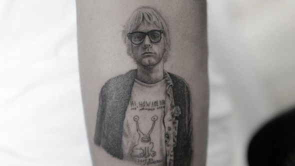 Kid Cudi's Kurt Cobain / Daniel Johnston tattoo