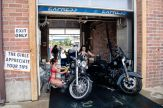 Women dressed in bikinis wash motorcycles at Bikini Bike Wash during the 80th annual Sturgis Motorcycle Rally on Saturday, Aug. 15, 2020, in Sturgis, S.D. (Amy Harris)