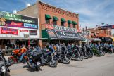 Motorcycles are parked along Main Street during the 80th annual Sturgis Motorcycle Rally on Saturday, Aug. 15, 2020, in Sturgis, S.D. (Amy Harris)
