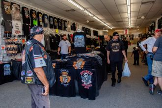 Bikers purchase Sturgis apparel during the 80th annual Sturgis Motorcycle Rally on Saturday, Aug. 15, 2020, in Sturgis, S.D. (Amy Harris)