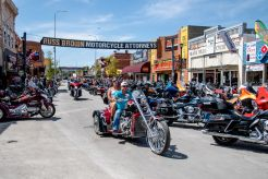 Bikers ride down Main Street during the 80th annual Sturgis Motorcycle Rally on Saturday, Aug. 15, 2020, in Sturgis, S.D. (Amy Harris)
