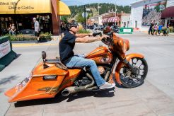 A biker rides down Main Street during the 80th annual Sturgis Motorcycle Rally on Saturday, Aug. 15, 2020, in Sturgis, S.D. (Amy Harris)