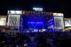 Motorcycles are parked in the audience during The Reverend Horton Heat's performance on the Wolfman Jack Stage at Buffalo Chip during the 80th annual Sturgis Motorcycle Rally on Saturday, Aug. 15, 2020, in Sturgis, S.D. (Amy Harris)