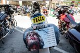 Wooden crosses are offered off the back of a Motorcycle during the 80th annual Sturgis Motorcycle Rally on Friday, Aug. 14, 2020, in Sturgis, S.D. (Amy Harris)