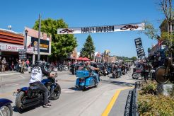 Bikers ride down Main Street during the 80th annual Sturgis Motorcycle Rally on Friday, Aug. 14, 2020, in Sturgis, S.D. (Amy Harris)