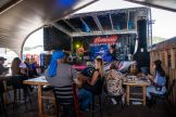 People watch as The Eskimo Brothers Band performs at the Loud American Bar & Restaurant during the 80th annual Sturgis Motorcycle Rally on Friday, Aug. 14, 2020, in Sturgis, S.D. (Amy Harris)