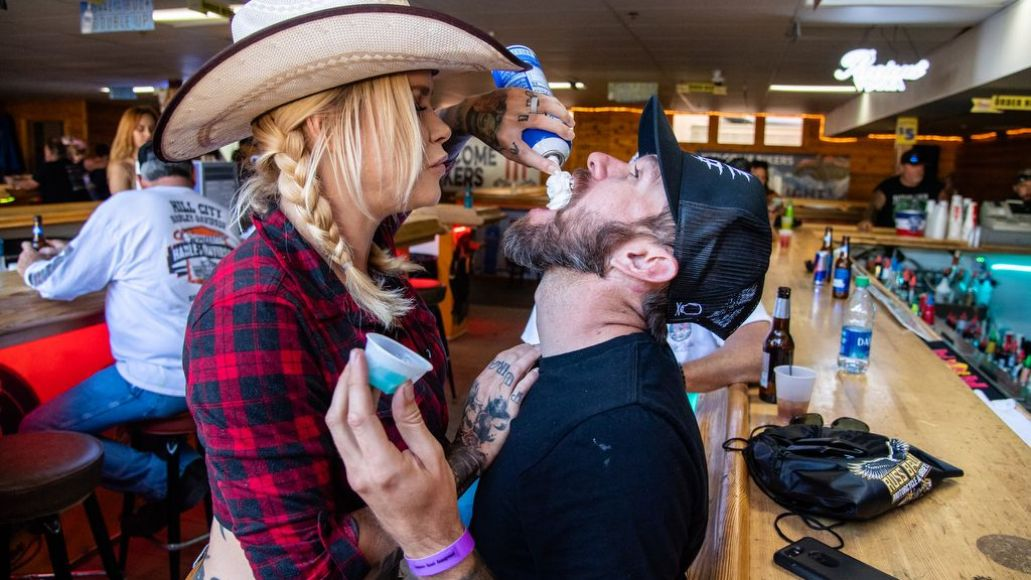 A bar patron receives a jello shot with whipped cream at One Eyed Jacks Saloon during the 80th annual Sturgis Motorcycle Rally on Friday, Aug. 14, 2020, in Sturgis, S.D. (Amy Harris)