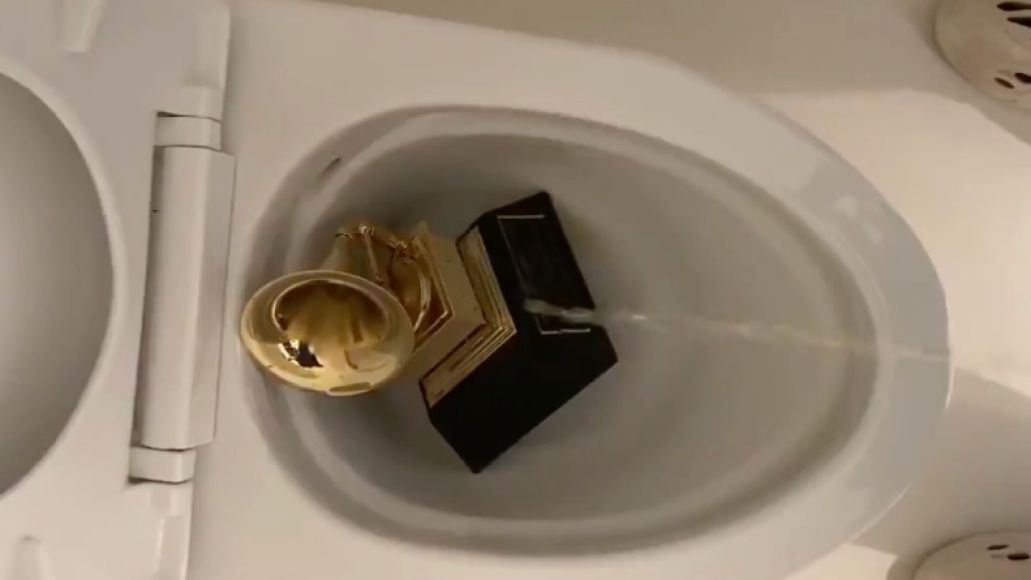 Kanye West urinates on Grammy, photo via artist