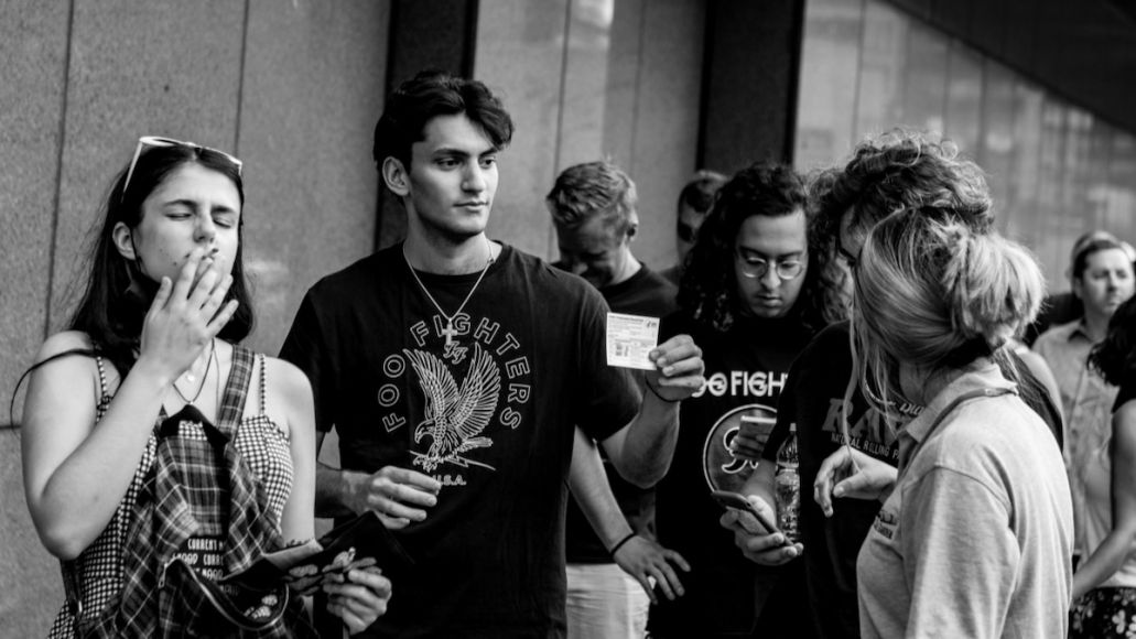 Fans have their COVID-19 vaccination cards checked before entering the Foo Fighters concert at Madison Square Garden, photo by Alexi Rosenfeld/Getty Images
