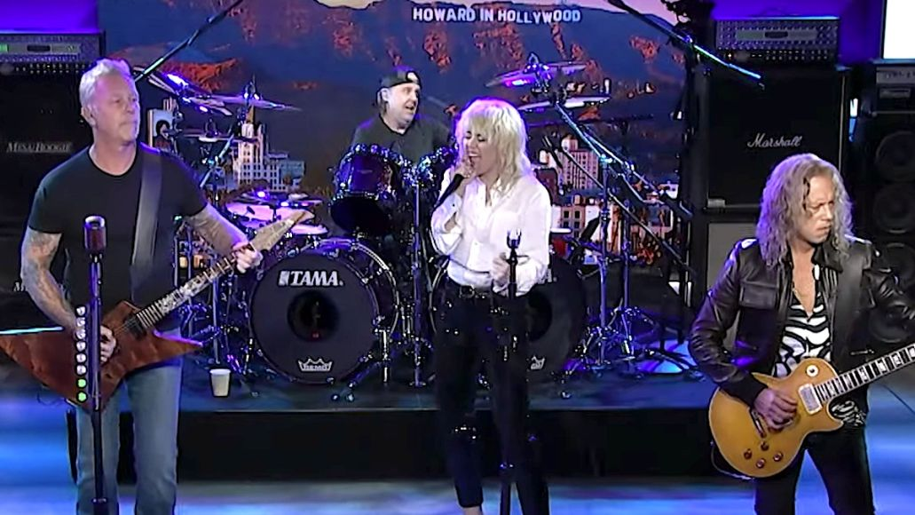 Miley Cyrus performs with Metallica